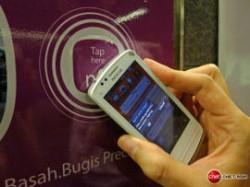 NFC-Einsatz mit Nokia-Smartphone (Bild: CNET Asia)
