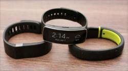 Microsofts Fitness-Armband soll Produkten wie Fitbit Flex (links), Samsung Gear Fit (mitte) und Nike FuelBand (rechts) ähneln (Bild: Sarah Tew/CNET).