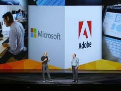 Microsoft-Chef Satya Nadella (links) und Adobe-CEO Shantanu Narayen 2014 (Screenshot: Stephen Shankland/CNET)